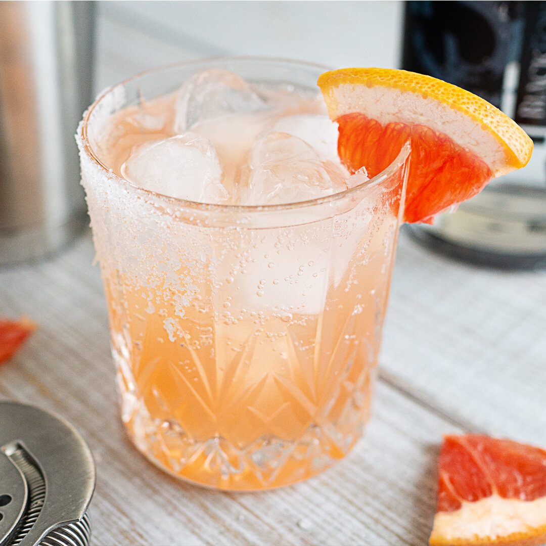 Canadian Gin with 750ml Gin #3 bottle and Gin Paloma cocktail with grapefruit garnish
