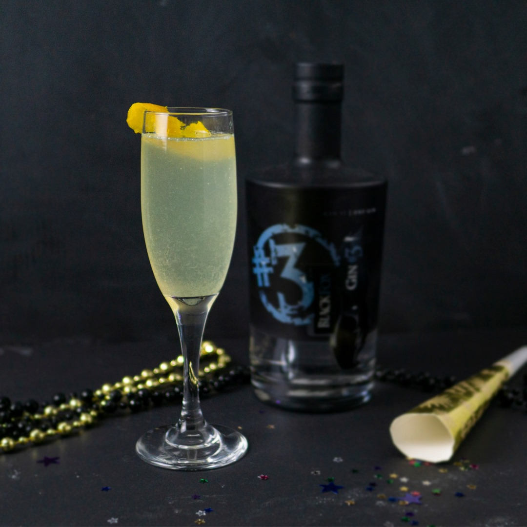 Canadian Gin with French 75 cocktail and lemon garnish